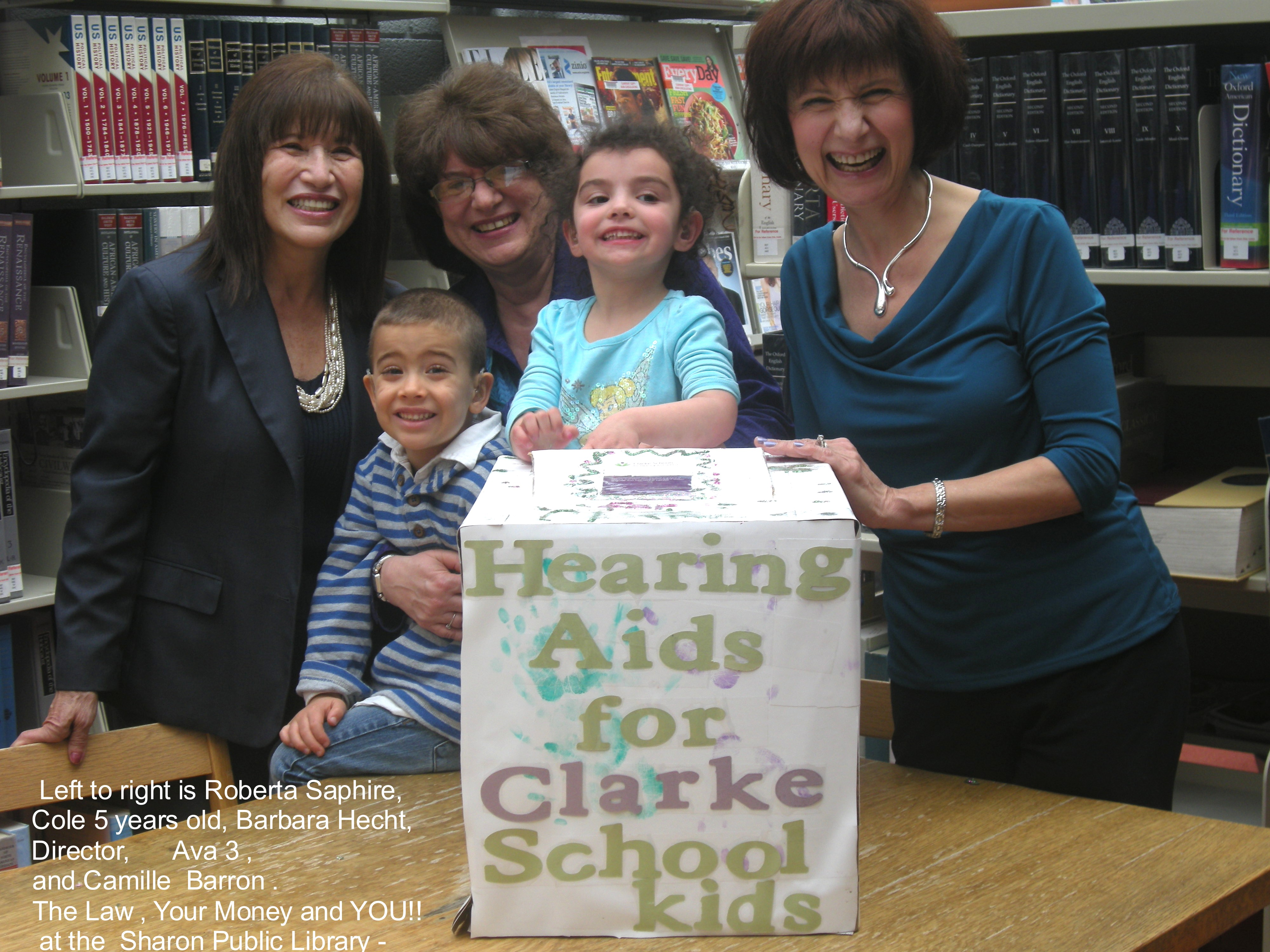 Roberta and Camille standing with Barbara Hecht and students Ava and Cole